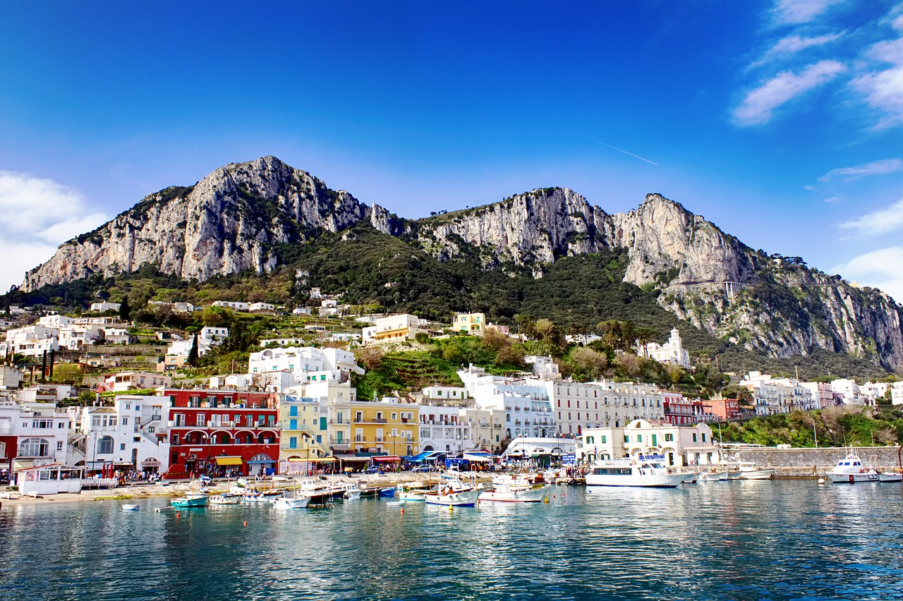 Capri - image of the island seen from the sea, multicolored houses stand out on the coasts