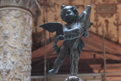 Putto statue with dolphin