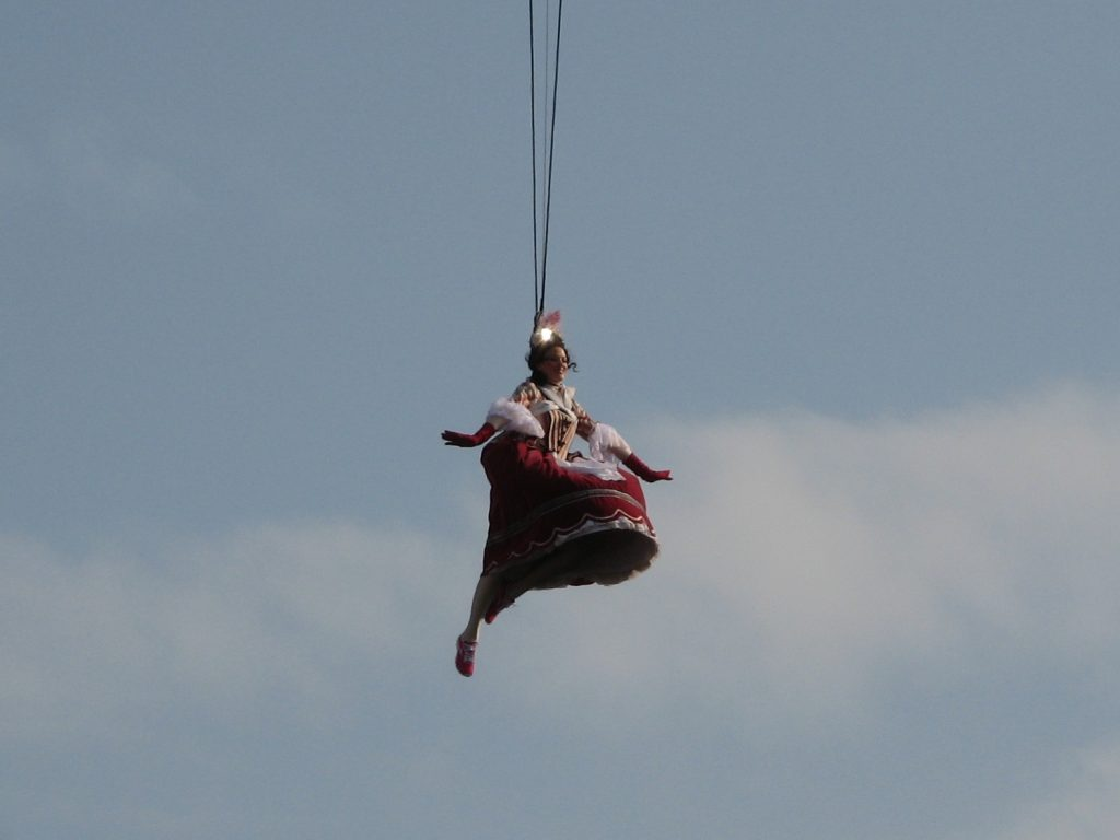 Venice Carnival - The Flight of the Angel interpreted by a girl in a historical dress supported by a safety rope