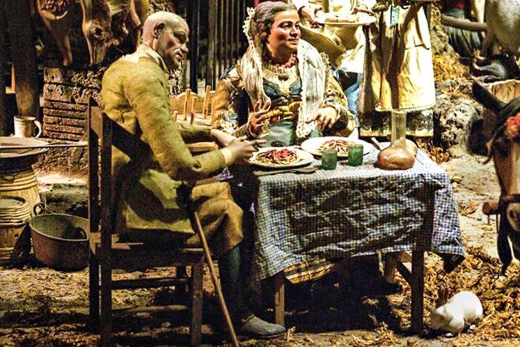 Spaghetti - Immagine di un uomo e una donna seduti al tavolo pronti a consumare un abbondante piatto di spaghetti al pomodoro