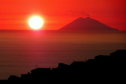 stromboli - the amazing scenery of the sunset over the stromboli