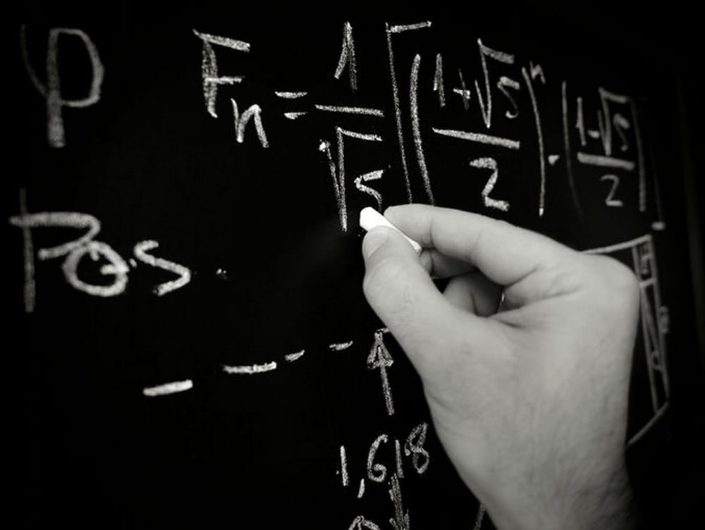 Thomas Passera - numbers and formulas on the board