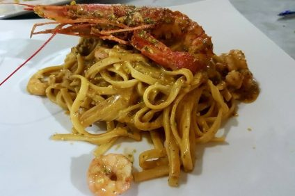 pasta - linguine with lobster resting on top