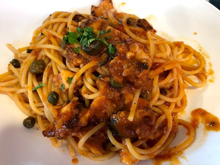 pasta - spaghetti with sauce with capers, olives and polyps
