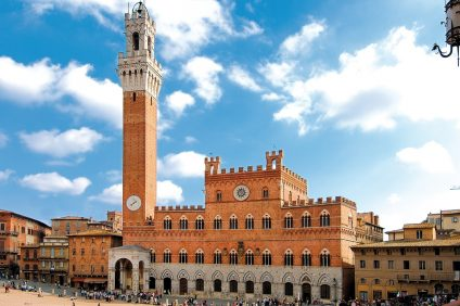 Siena. Piazza del Campo with the first floor of the town hall and civic tower in red brick