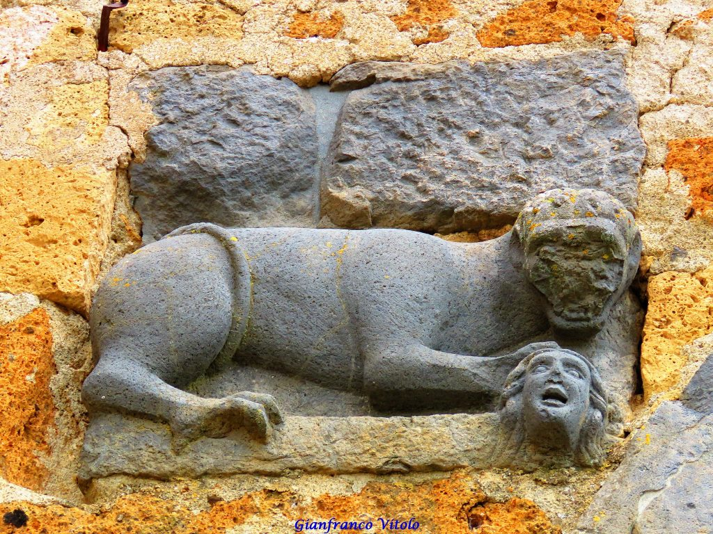 Civita di Bagnoregio. Detail of a high relief with a lion under whose paw crushes a man's head