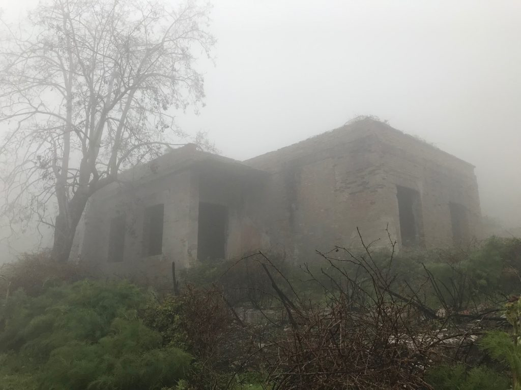 ruin of the village of morfia wrapped in fog