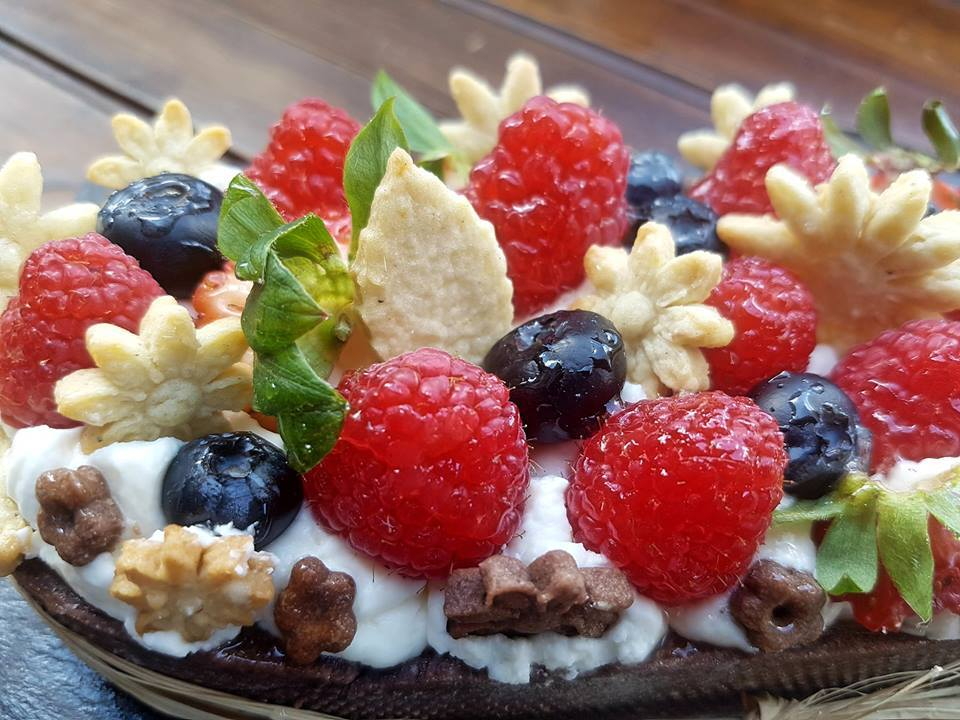 sweet pastry with cream and fruit on top