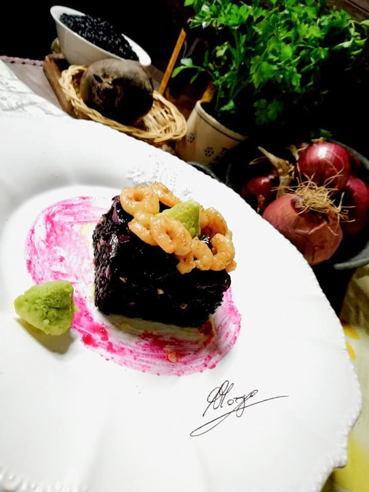 dish with square of venus rice beetroot and shrimps