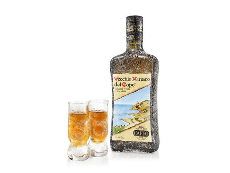 bottle and  two glasses full of Vecchio amaro del capo
