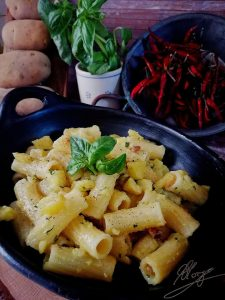 pot with bacon rigatoni and basil leaf