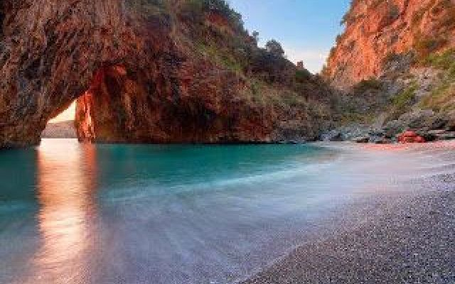 San Nicola Arcella.The Great Arch opens a passage in the rock that houses a small sandy beach