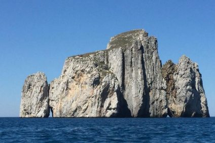 The stacks called Pan di Zucchero, facing the beach of Porto Flavia