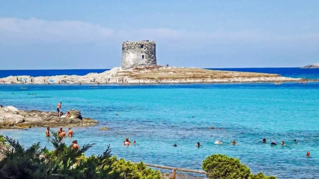 pelosa beach: bathers and Aragonese tower