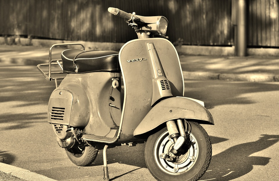 vespa - in a black and white picture