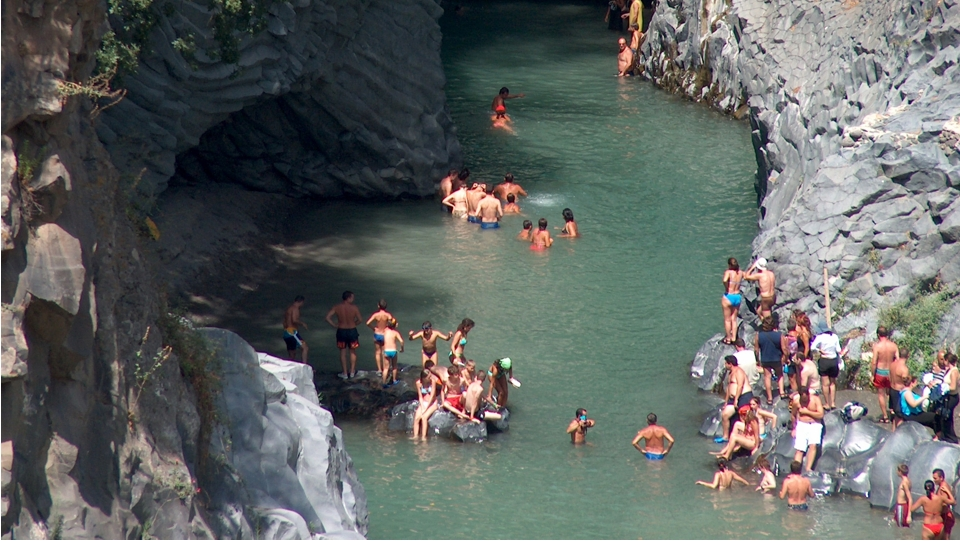 Tourists who bathe in the Alcantara Gorges
