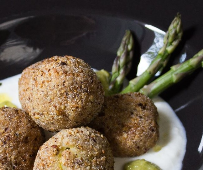 close-up of rice balls with asparagus with mozzarella mousse