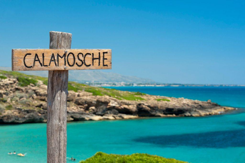 Calamosche beach is located between two rocky headlands