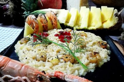 composition of Risotto with pineapple prawns and scented prawns with brandy