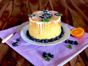 plate with Chiffon cake with orange, white chocolate and blueberries