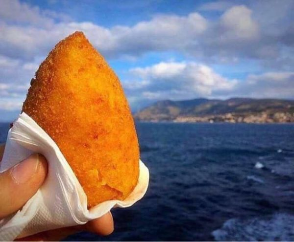 an arancino by the sea