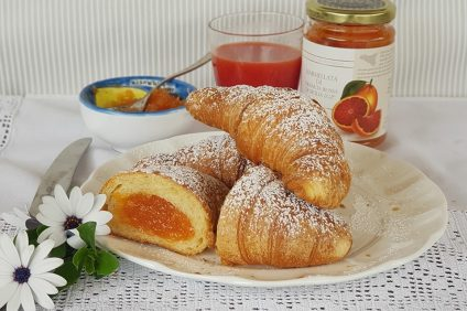 croissants with jam on a plate