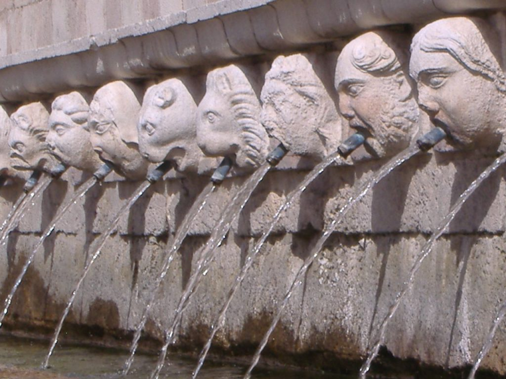 Fountain of the 99 spouts. Detail of masks