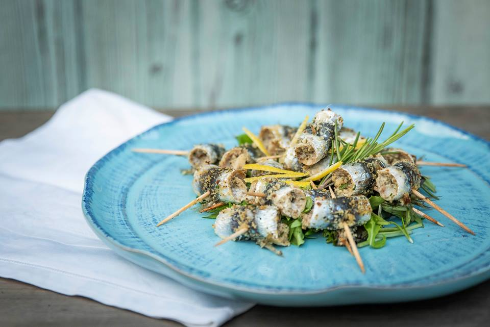 gratinated sardines with rosemary closed with toothpicks