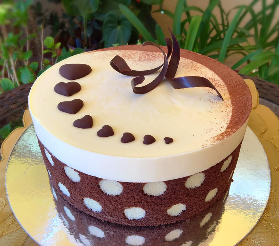 polka dot cake decorated with white and dark chocolate
