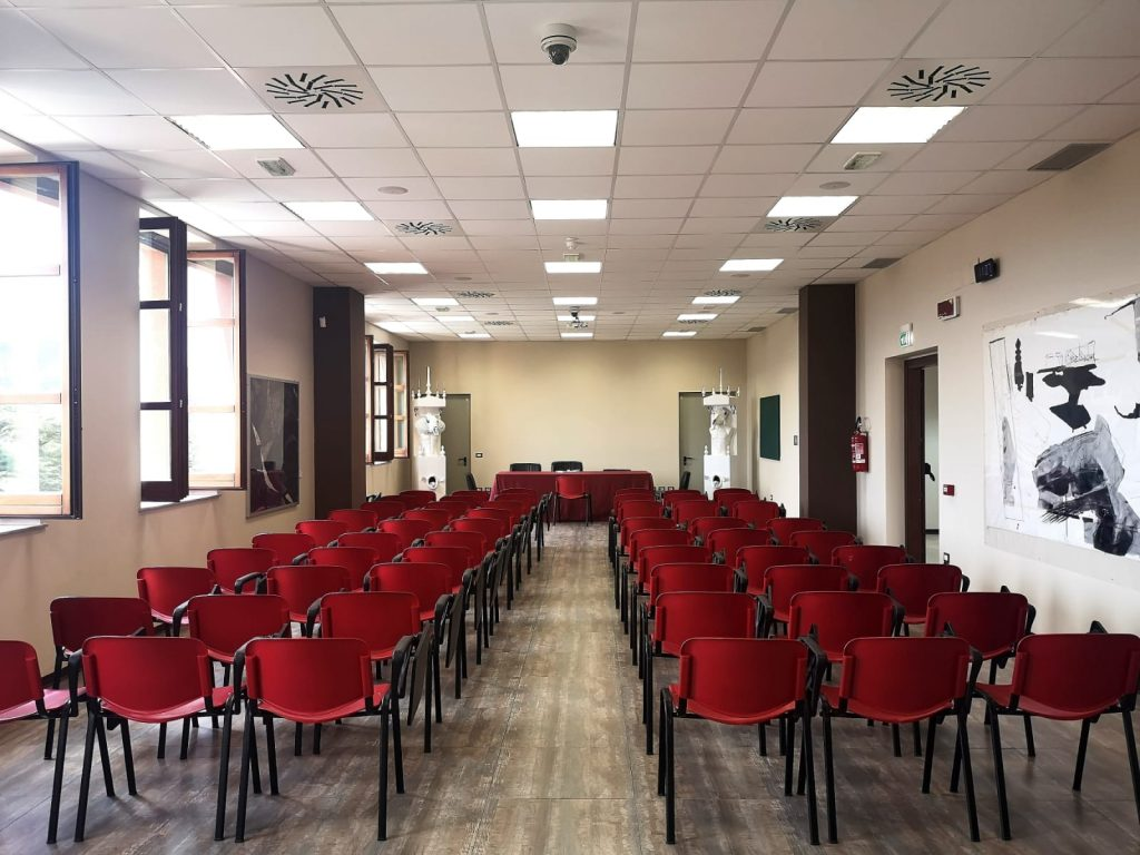 Catanzaro Academy of Fine Arts classroom with red chairs inside