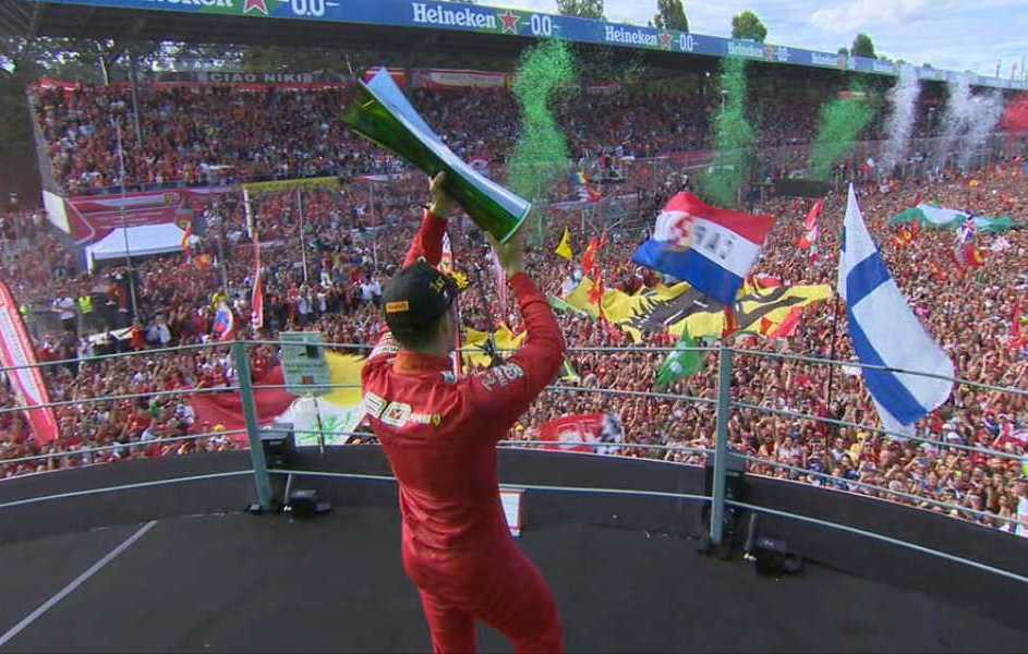 Charles Leclerc with the cup at the top in Monza