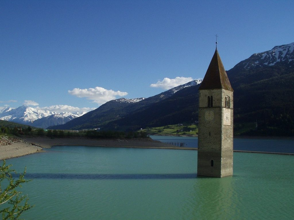 The submerged bell tower. Image of the bell tower of Resia immersed in the Val Venosta lake.