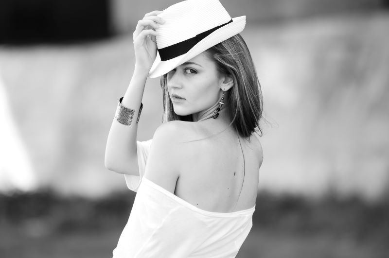 black and white photo of a model wearing a Borsalino hat