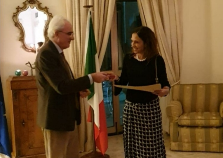 knight- delivery of the award to Paola Stranges by the Italian Ambassador Mario Sammartino