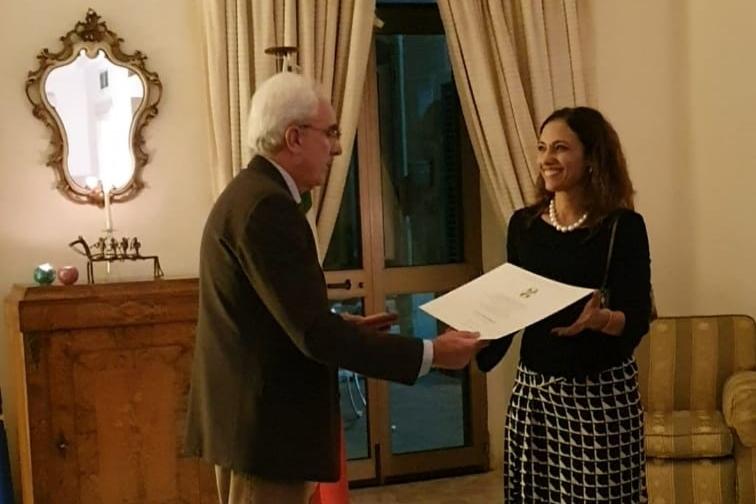 Knight- Paola Stranges receives the award from the Italian Ambassador Mario Sammartino