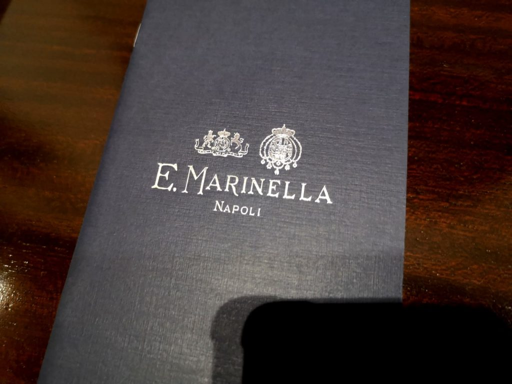 E. Marinella - blue brochure with silver colored writing