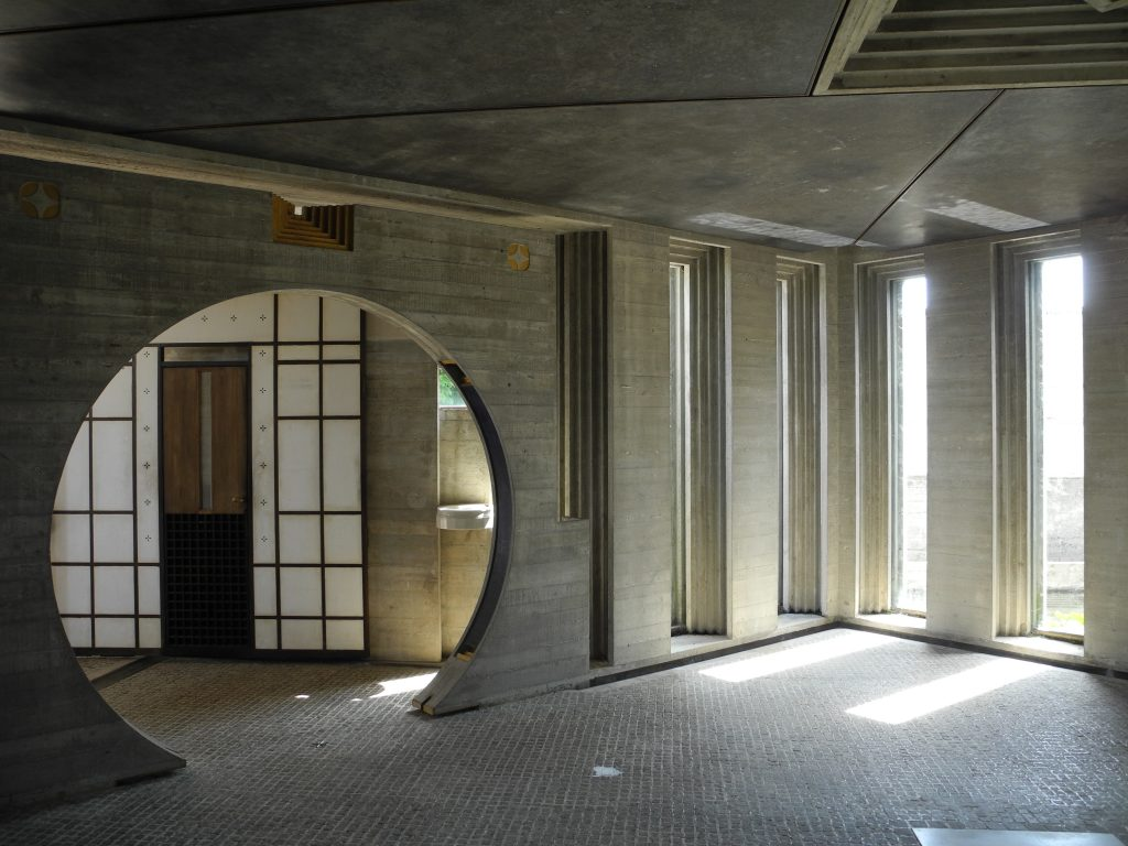 interior of sacred space made of stone and sliding walls of Japanese style wood