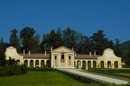 itinerary: white and yellow Palladian villa with green lawn in front