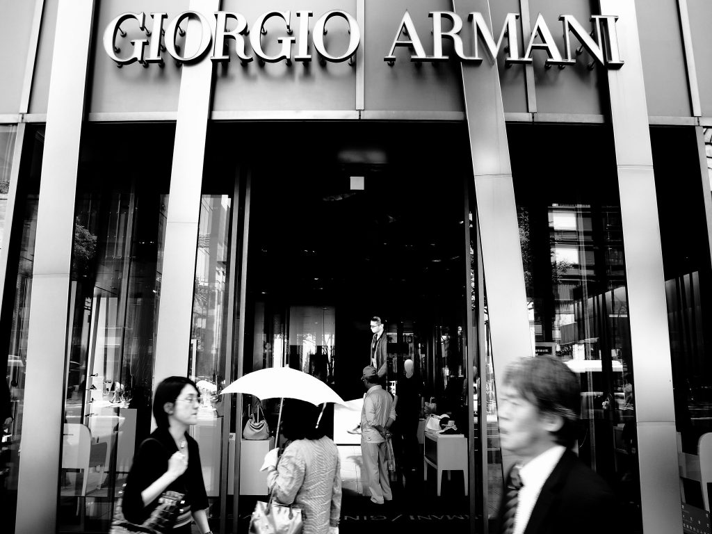 black and white photo of an entrance to a Giorgio Armani shop