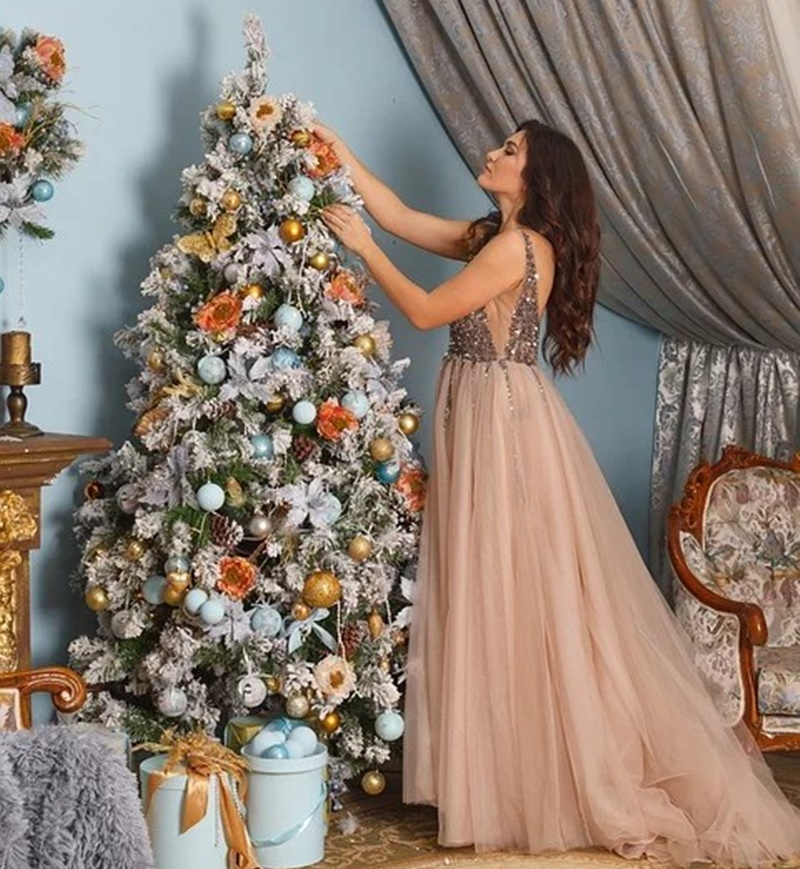 How to dress for New Year's Eve - girl decorating a tree