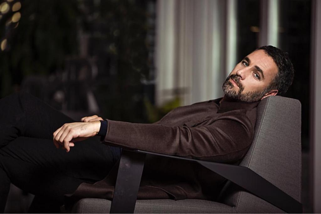 Giorgio Armani - sitting during a shooting