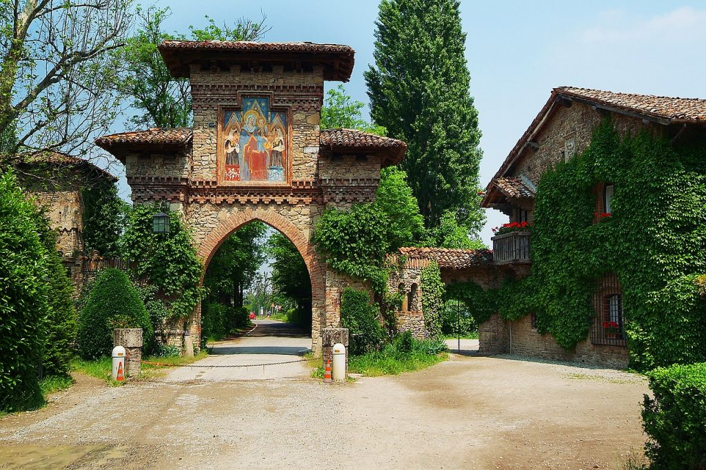 The ogival entrance arch of the village of Grazzano Visconti