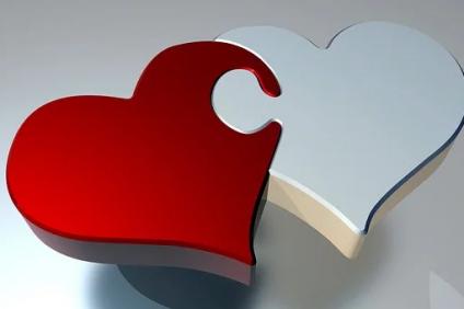 amore - immagine di due cuori vicini uno rosso e uno bianco