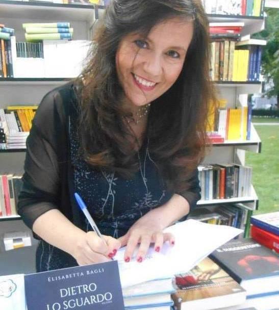 Elisabetta Bagli signs one of her books