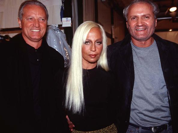 The stylist Gianni Versace with the brothers Santo and Donatella