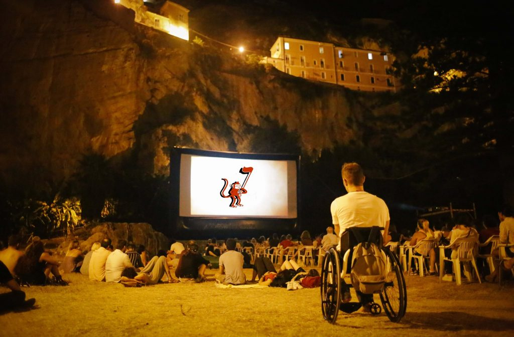 a photo of the last edition of la Guarimba. in the foreground a boy in a wheelchair. the festival is accessible to all