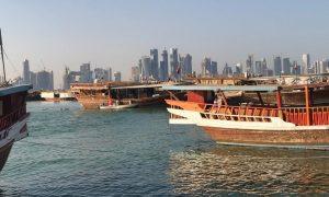 Italiani in Qatar - Imbarcazioni con lo sfondo di Doha