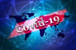 Contagi: il Covid 19 scritta bianca su banner rosso- Foto: Pixabay