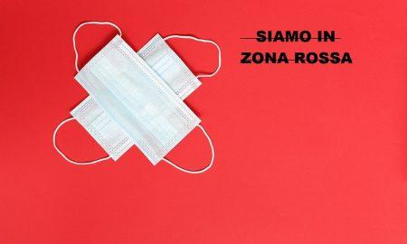 Zona rossa: due mascherine bianche su sfondo rosso - Foto: Pixabay